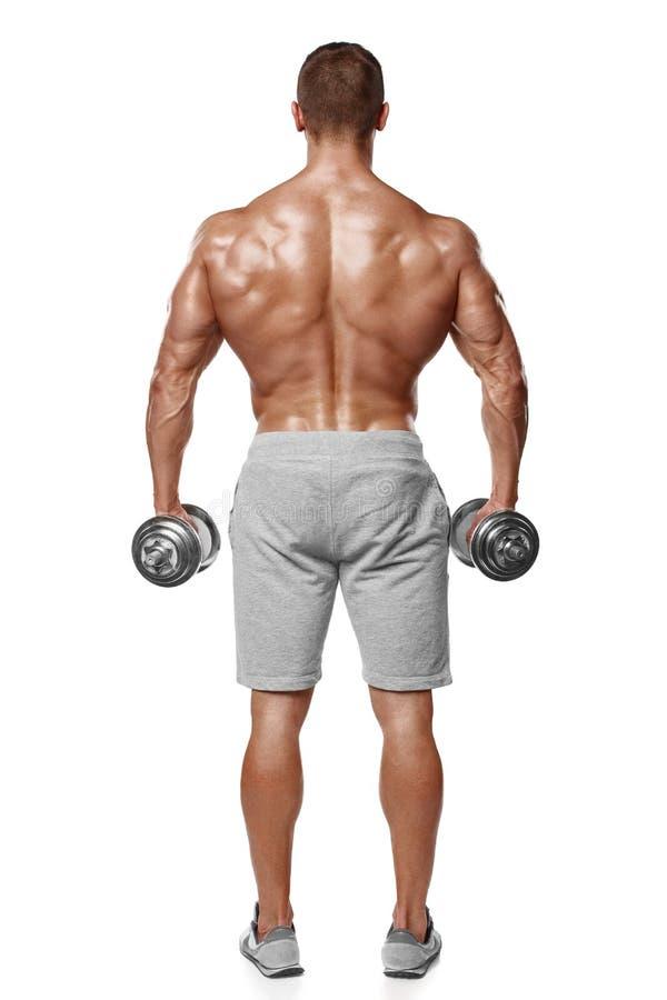 Sexy athletischer Mann, der muskulösen Körper mit Dummköpfen, hintere Ansicht, in voller Länge, lokalisiert über weißem Hintergru lizenzfreies stockfoto