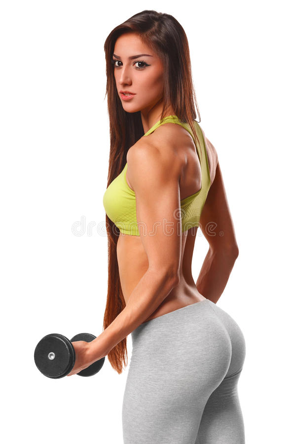 Sexy atletische vrouw die met domoren uitwerken Sexy mooie ezel in leren riem Geschiktheidsmeisje, op witte achtergrond wordt geï