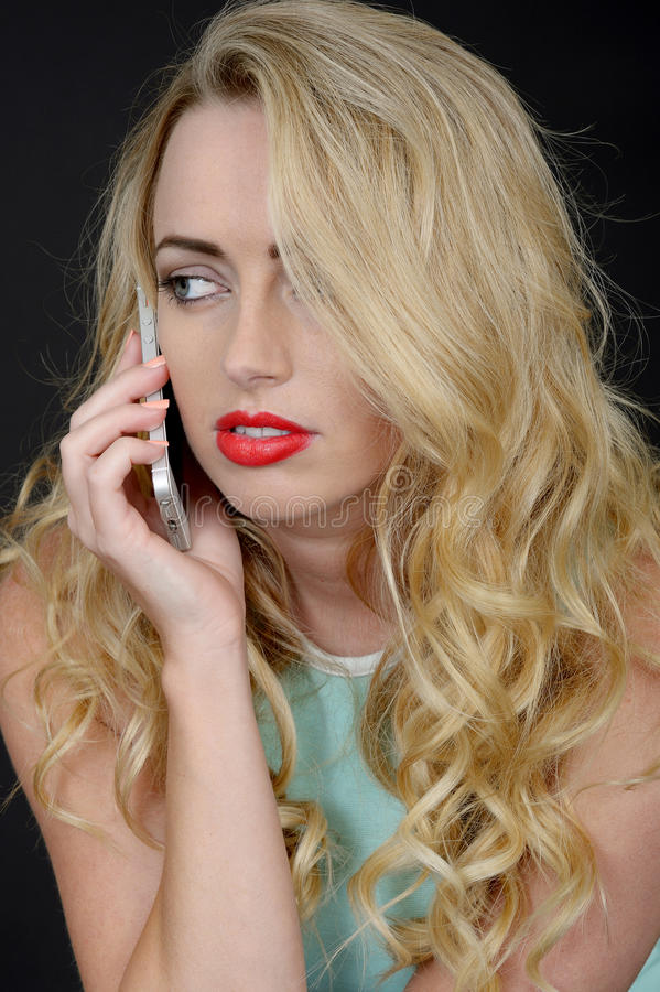 Attactive Young Woman Using a Mobile Telephone royalty free stock images