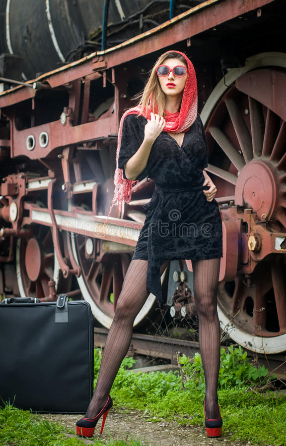 Download Attractive Girl Waiting For Landing On The Platform In The Vintage Train Stock Photo - Image: 30664444