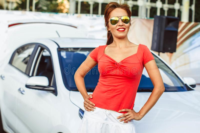 Women in front of car stock photos