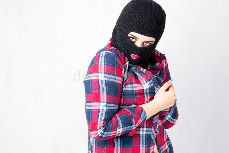 Bandit girl, fat model in balaclava, Woman Plus Size in shi. Rt posing topless on white background with brown eyes. XXL female in black mask hidding her boobs stock photography
