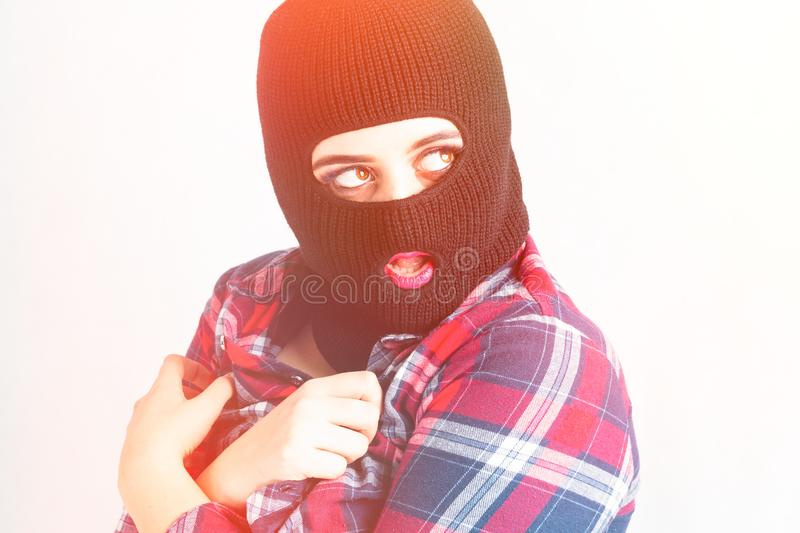 Bandit girl, fat model in balaclava, Woman Plus Size in shirt posing topless on white background with brown eyes. XXL female. In black mask hidding her boobs royalty free stock photos