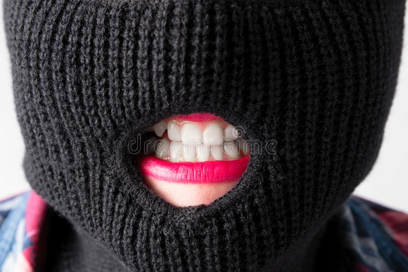 Bandit girl, fat model in balaclava, Woman Plus Size in shirt posing topless on white background. XXL female in black mask w. Ith lips tongue teeth royalty free stock image