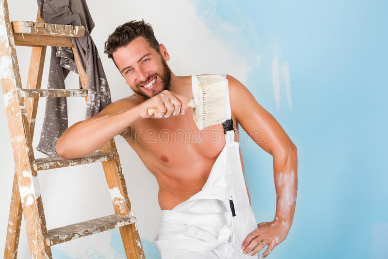 Bare chest painter stock image. Image of building