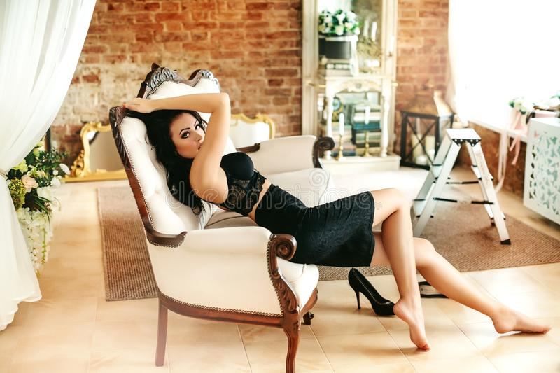 beautiful brunette woman in black stock photography