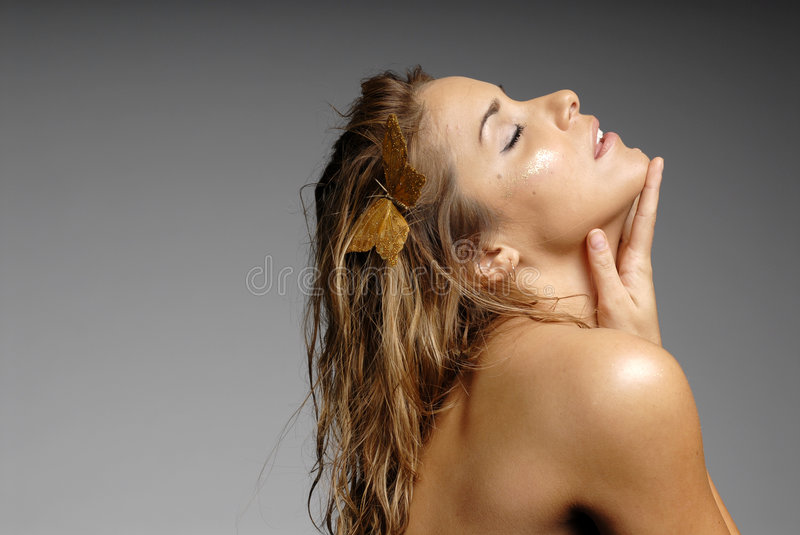 beautiful with butterfly on her hair - makeup stock image