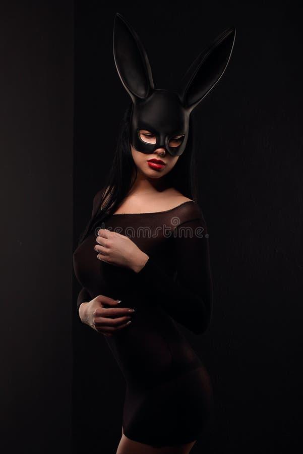 Sexy, beautiful, charming, woamn in black rabbit mask and elegant dress. Sexy, beautiful, charming, woamn in black rabbit mask and elegant dress, studio stock photography