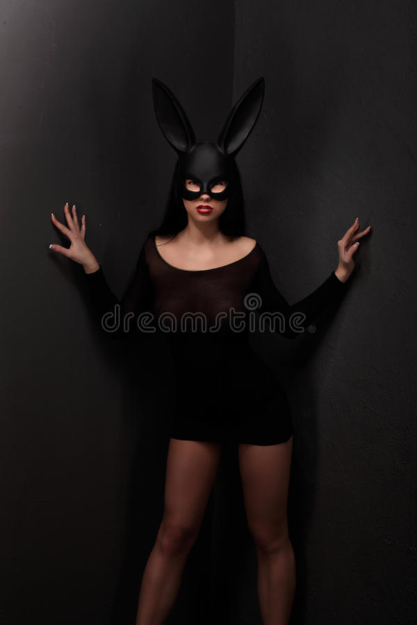 Sexy, beautiful, charming, woamn in black rabbit mask and elegant dress. Sexy, beautiful, charming, woamn in black rabbit mask and elegant dress, studio stock images
