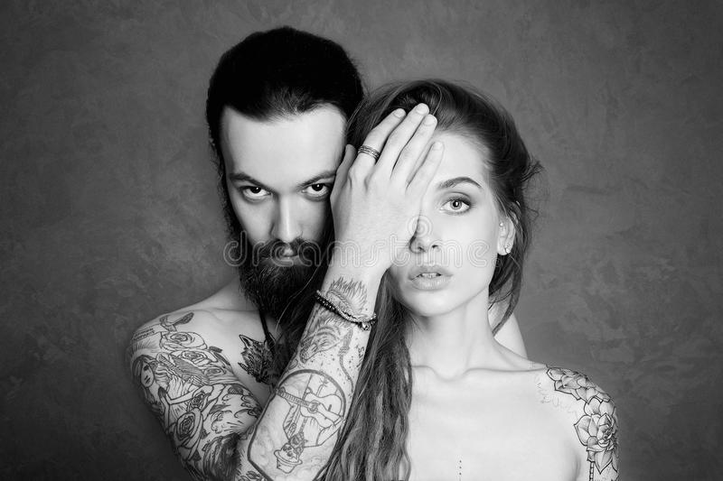 Beautiful couple with tattoo.woman and man. Beautiful couple with tattoo.beauty women and handsome man.lovely boy and girl stock photography