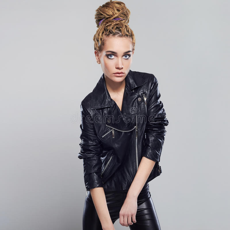 beautiful girl with dreadlocks. punk rock young woman in leather stock image