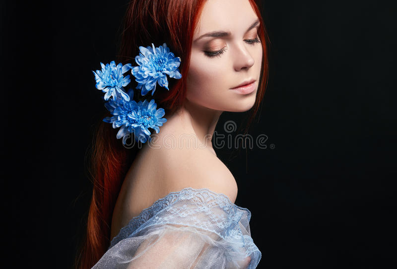 beautiful redhead girl with long hair in dress cotton retro. Woman portrait on black background. Deep eyes. Natural beauty royalty free stock photos