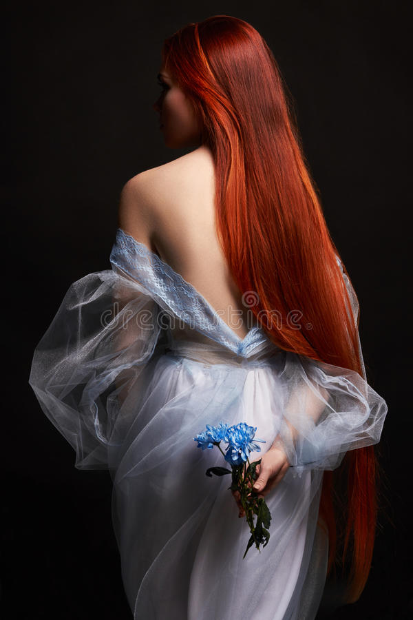 beautiful redhead girl with long hair in dress cotton retro. Woman portrait on black background. Deep eyes. Natural beauty royalty free stock photography