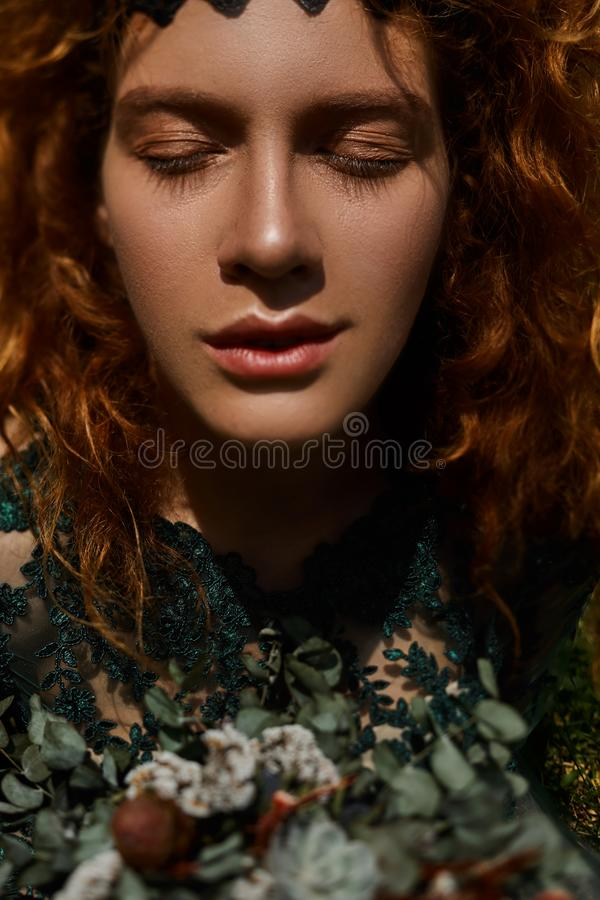 Close up portrait of a beautiful redhead girl playing with hair stock images