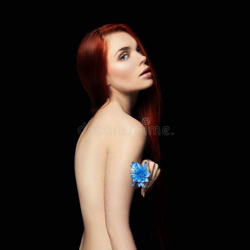 beautiful redhead girl with long hair. Perfect woman portrait on black background. Gorgeous hair and deep eyes Natural beauty royalty free stock photos
