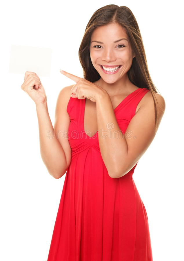 beautiful smiling woman pointing at sign card stock image
