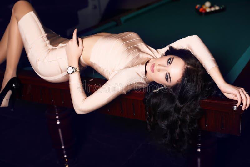 beautiful woman with dark hair in elegant gold dress royalty free stock photo