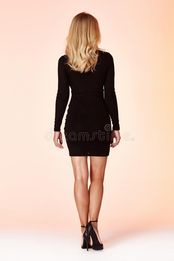 Free Sexy Beautiful Woman Pretty Face Bright Makeup Cosmetic Face Care Long Hair Blond Wear Clothes Short Skinny Black Dress Date Or Royalty Free Stock Photography - 148131927