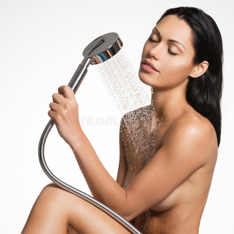 beautiful woman in shower washing body stock images