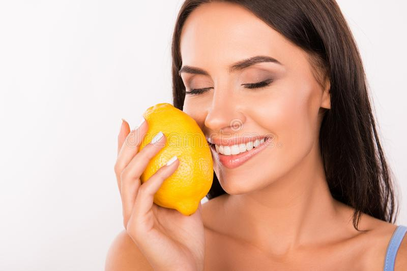 Sexy beautiful young woman sniffing the scent of lemon stock image