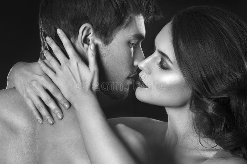 Beauty couple. Kissing couple portrait. Sensual brunette woman in underwear with young lover, passionate couple. Beauty couple. Kissing couple portrait. Sensual stock photos