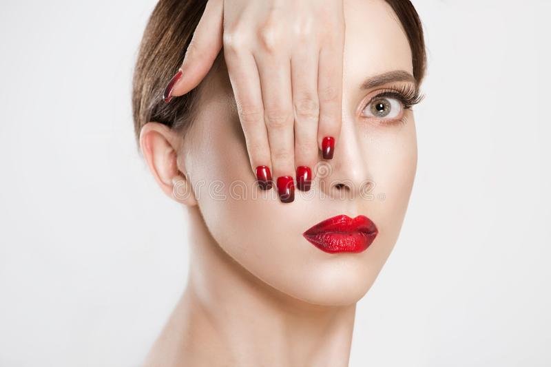 Sexy Beauty Girl with black eyelashes Red Lips and Nails. Provocative natural Make up. Luxury Woman with green Eyes. Fashion royalty free stock photography