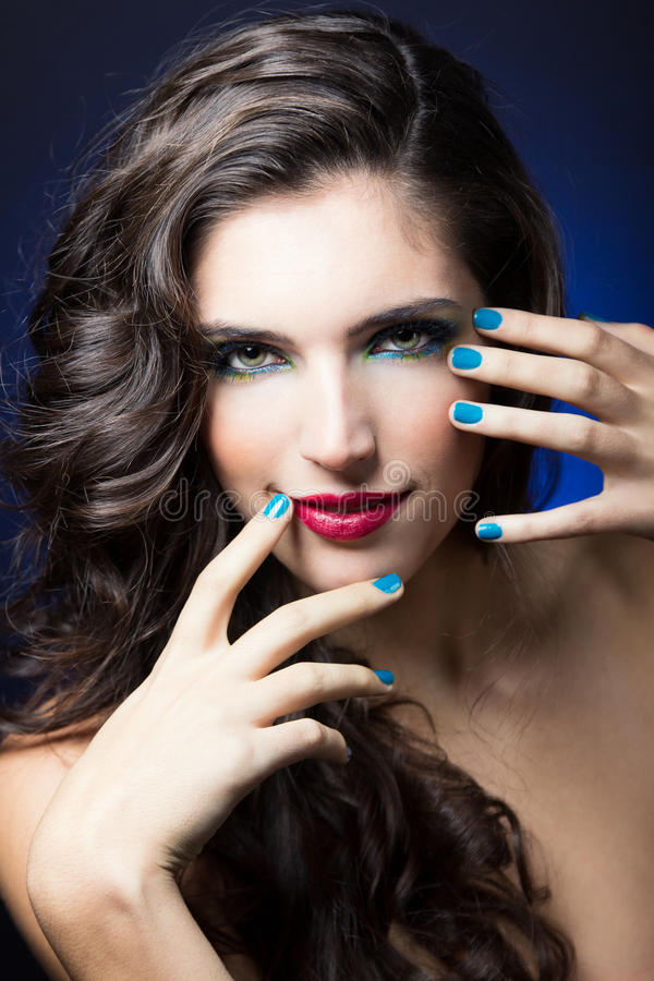 Beauty Girl with Red Lips and blue Nails. Make up portrait of Beauty Girl with Red Lips and blue Nails royalty free stock photography