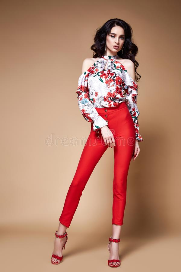 beauty woman pretty face tan skin wear silk blouse red pant stock image