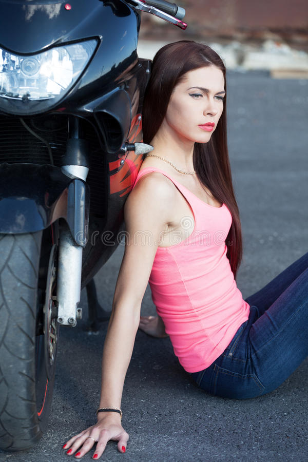 Biker. Sitting next to sport bike royalty free stock photography