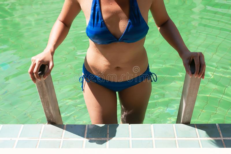 bikini woman with belly fat. 40s woman`s health royalty free stock images