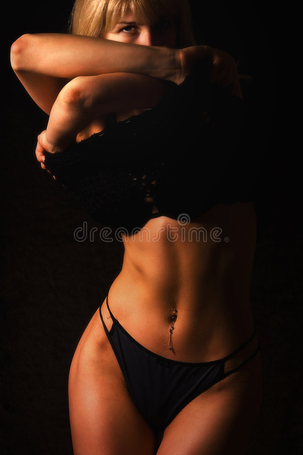 Blond. A blond stripping in the dark royalty free stock photos