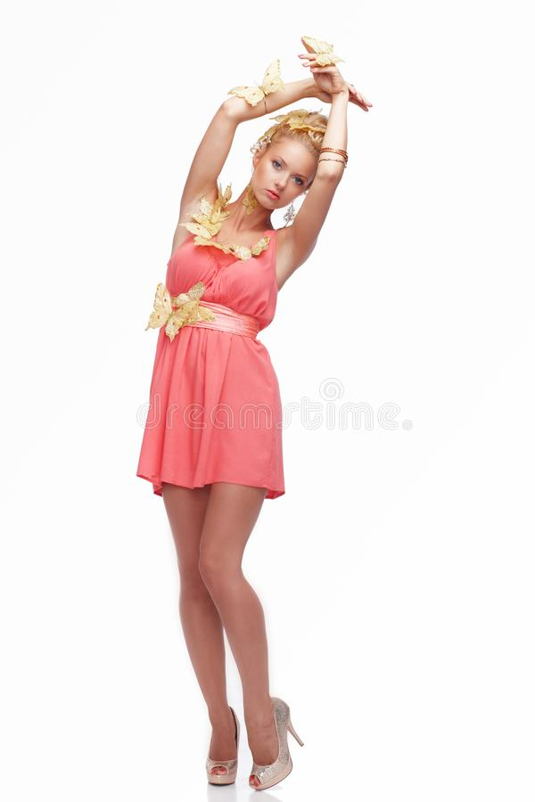 blond female in pink dress stock photos