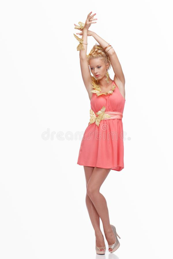 blond female in pink dress royalty free stock images