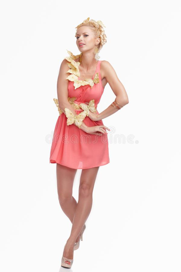 blond female in pink dress stock photo