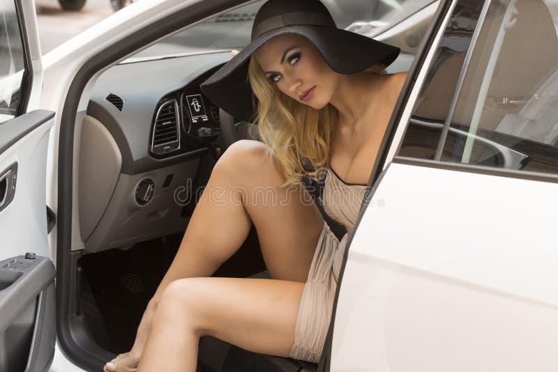blond girl in car stock photo