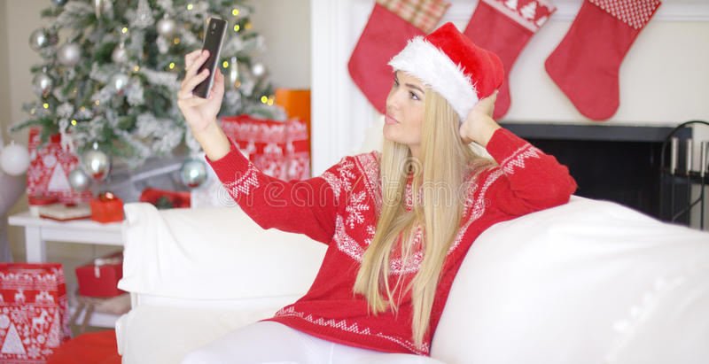 Blond Girl In Christmas Outfin Taking A Selfie Stock Image - Image ...