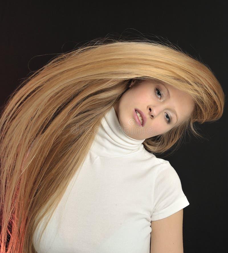 Caucasian blonde teenage girl with long blonde hair, facing stock photo