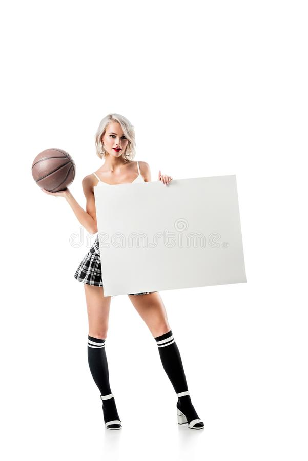 Free Sexy Blond Woman In Short Plaid Skirt With Basketball Ball And Empty Banner Posing Stock Image - 129086071