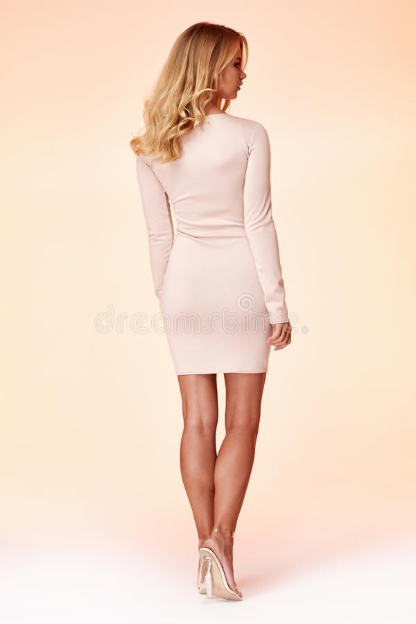 Free Sexy Blond Woman Skinny Business Style Dress Beige Color Perfect Body Shape Diet Busy Glamour Lady Casual Style Secretary Stock Image - 148131841