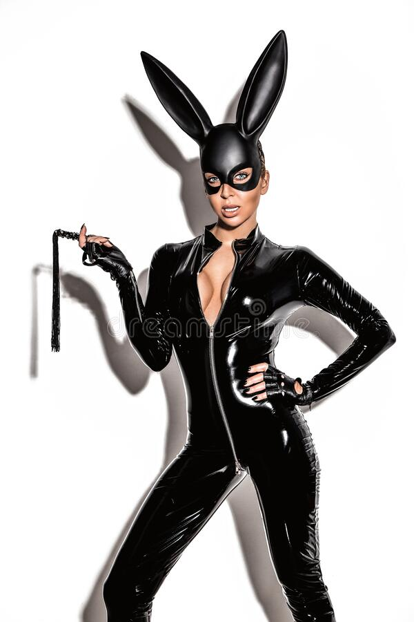Free Sexy Blonde Beautiful Woman Posing In Latex Costume And Black Bunny Mask On White Background. Royalty Free Stock Images - 176718299
