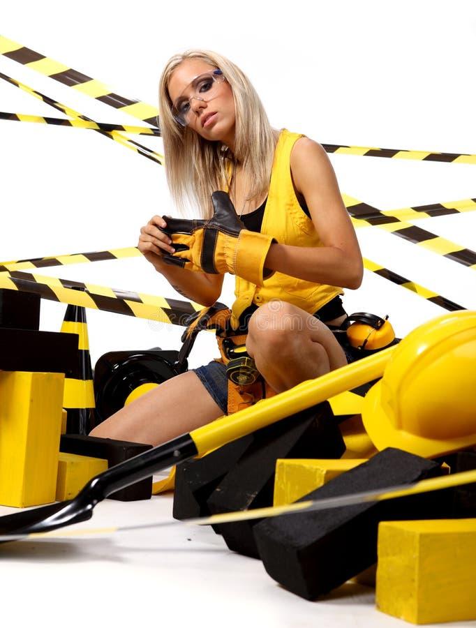 Sexy blonde bouwvakker stock foto's