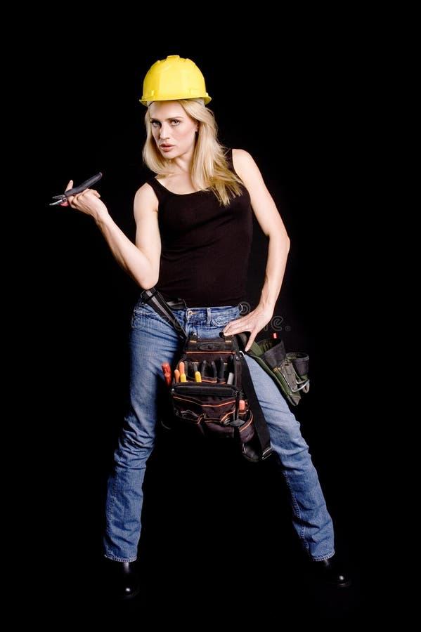 Sexy blonde bouwvakker stock afbeeldingen