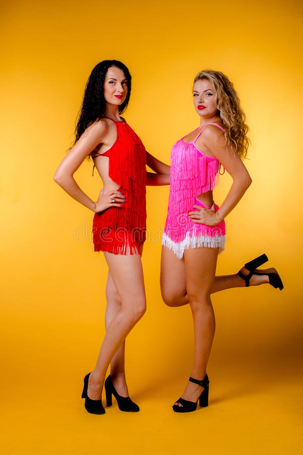 blonde and brunette in the studio royalty free stock photo