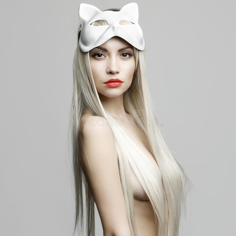 blonde in cat mask stock images