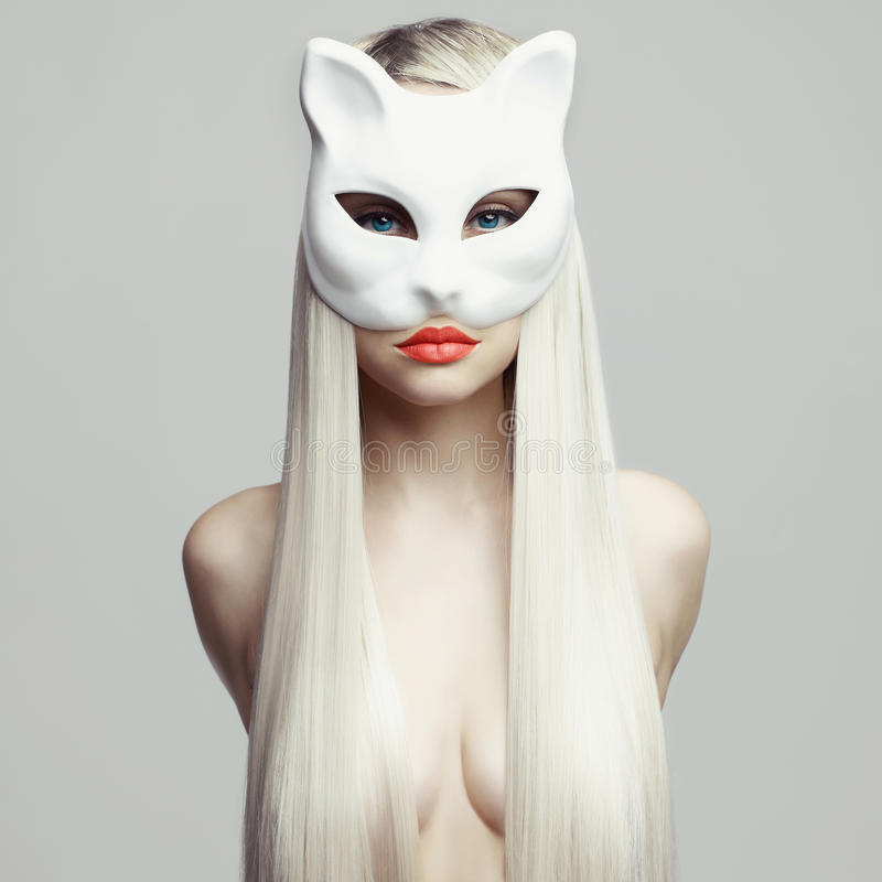 Blonde in cat mask. Fashion photo of beautiful blonde in cat mask