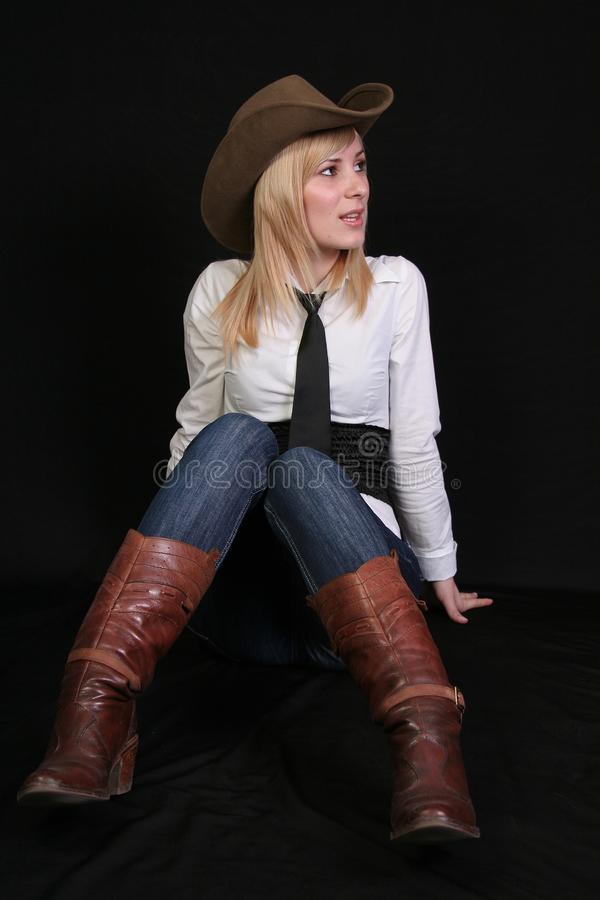 Blonde cowgirl stock photography