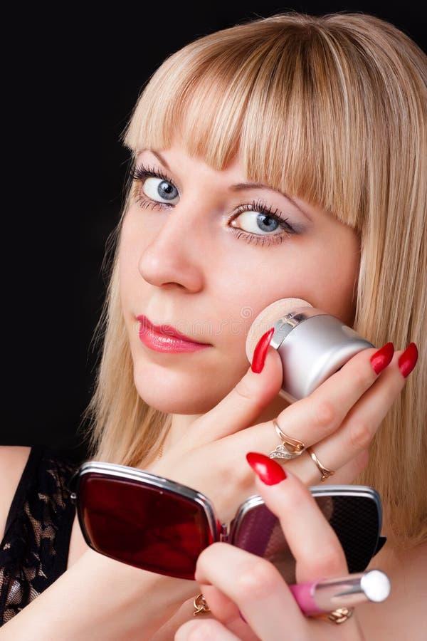 Download Blonde doing make-up stock image. Image of application - 24873665