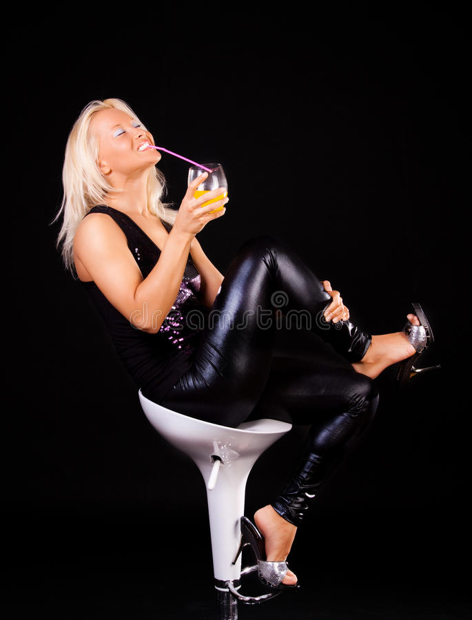 blonde is drinking royalty free stock photography