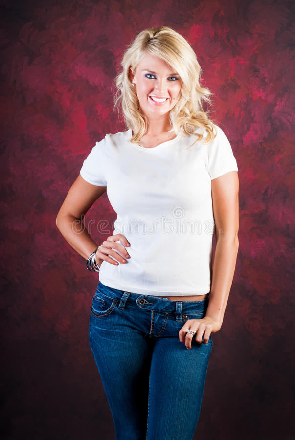 blonde girl fashion model in blue jeans royalty free stock photography