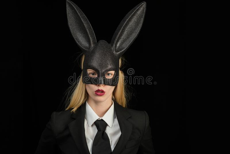 Sexy blonde girl with lace bunny ears. Beautiful woman in fashion bunny mask. Egg hunt. Rabbit woman wearing ears royalty free stock photo